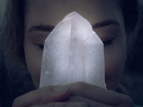 What can I expect to experience during a crystal healing session?